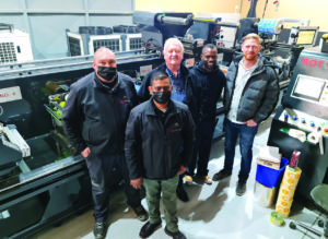 ROTOCON technicians Reggie Gilbert and Sachin Sukhlal with Uni-Nam Labels' owners, Barry Skjoldhammer and Schalk Burger, and the operator of the ECOLINE RFP 340, Johannes Tushimbeni. In preparation for the commissioning of this eight-colour flexo press, the company had to install a new transformer and mini substation to upgrade its power supply from 80 to 300 Amps.