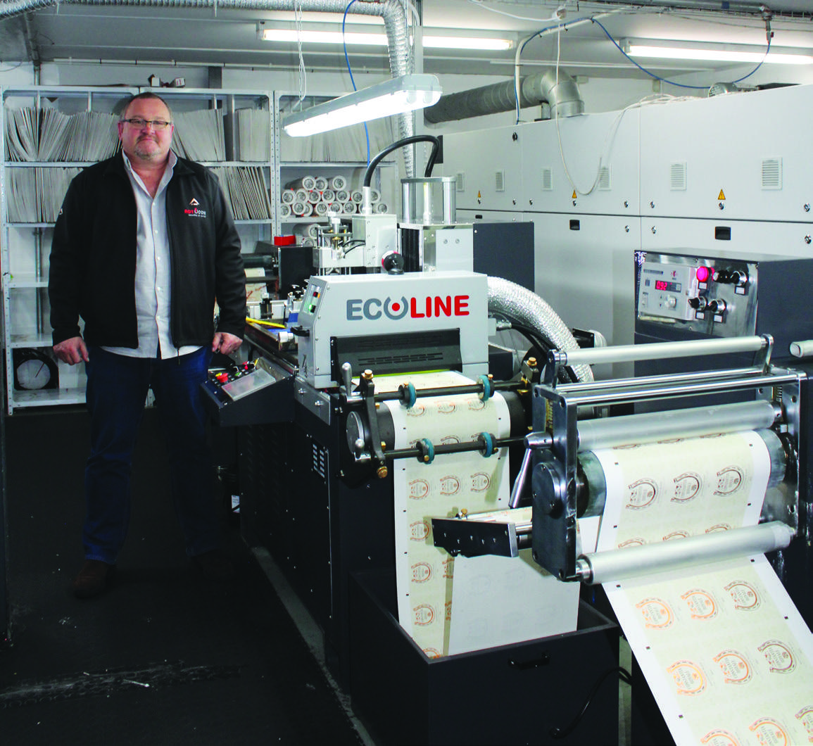 Win-Pak's print manager Basil Forbes is impressed with ROTOCON's ECOLINE flatbed silkscreen press.